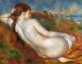 Naked girl, resting in the marram grass.