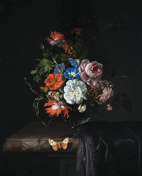 A Still Life of Flowers in a vase on a ledge