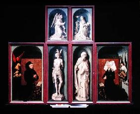 The Last Judgement when closed, depicting the donors Chancellor Nicholas Rolin and his Wife, Guigone