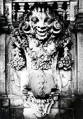 Smiling face with garlands, detail of fountain in Dresden, Germany