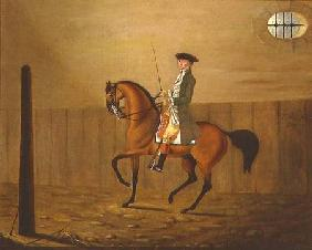Gentleman on a Bay Horse in a Riding School