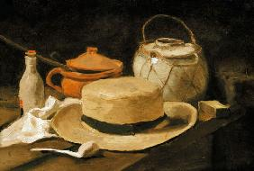 Still life with a yellow straw hat