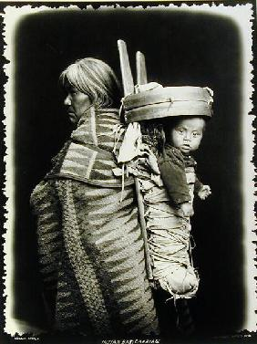 Navaho woman carrying a papoose on her back, c.1914 (b/w photo)